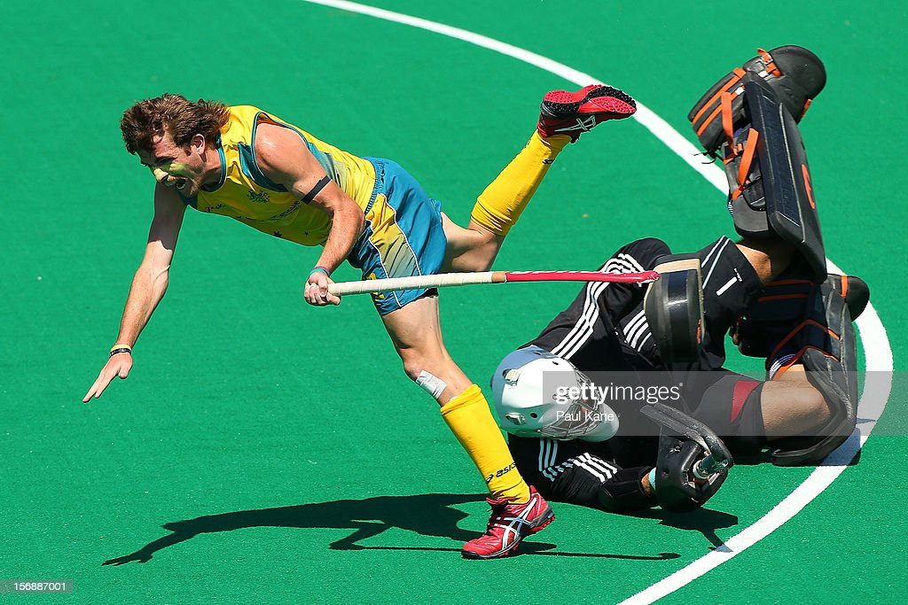 Jacob Whetton of the Kookaburras collides with George Pinner of England in the mens Australia Kookaburras v England game during day three of the 2012 International Super Series at Perth Hockey Stadium on November 24, 2012 in Perth, Australia.