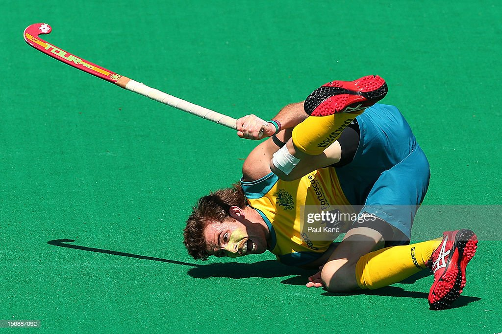 Jacob Whetton of the Kookaburras rolls on the turf after colliding with George Pinner of England in the mens Australia Kookaburras v England game during day three of the 2012 International Super Series at Perth Hockey Stadium on November 24, 2012 in Perth, Australia.
