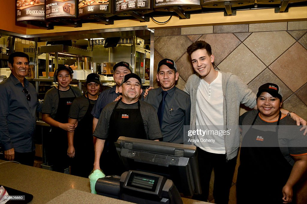 Jacob Whitesides (2nd R) gives a surprise performance in Los Angeles, CA at Taco Bells first ever pre-order event on February 6, 2016.