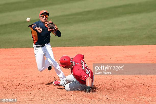 Jacob Wilson of the St Louis Cardinals is tagged out at second base by Ronald Torreyes of the Houston Astros during the sixth inning of a spring...