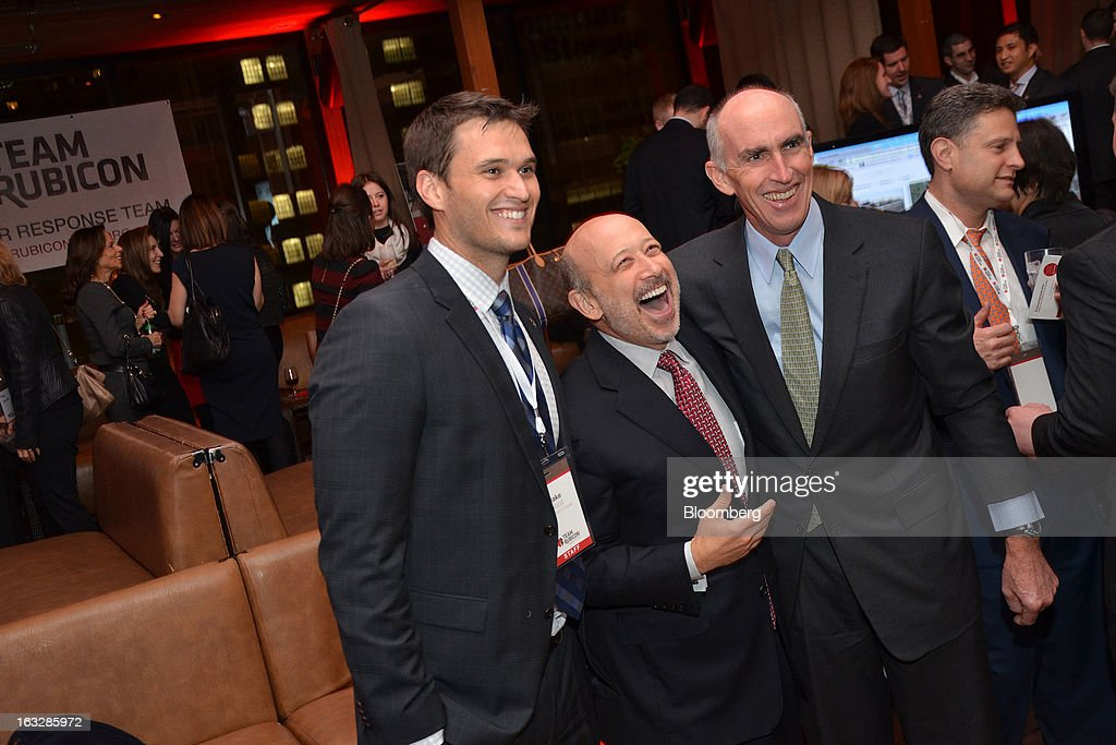 Jacob Wood, president and co-founder of Team Rubicon, from left, Lloyd C. Blankfein, chief executive officer of Goldman Sachs Group Inc., and Dick Cashin, founder of One Equity Partners LLC, attend a fundraiser for Team Rubicon at Hudson Terrace nightclub in New York, U.S., on Tuesday, March 5, 2013. Los Angeles-based non profit Team Rubicon deploys veterans on disaster relief missions in the U.S. and abroad. Photographer: Amanda Gordon/Bloomberg via Getty Images