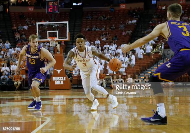 Jacob Young of the Texas Longhorns drives between Aaron Korn and Michael Buckland of the Lipscomb Bisons at the Frank Erwin Center on November 18...