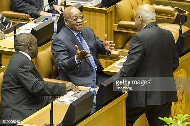 Jacob Zuma South Africa's president center speaks to Cyril Ramaphosa South Africa's deputy president left and Pravin Gordhan South Africa's finance...