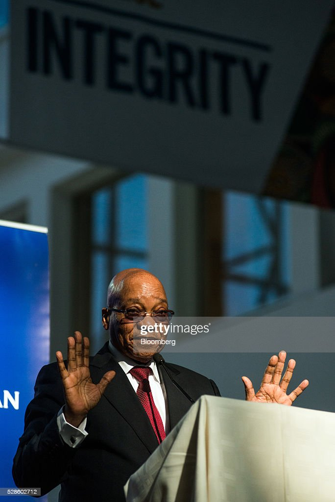 Jacob Zuma, South Africa's president, gestures whilst speaking during a visit to the offices of South African Airways (SAA) in Johannesburg, South Africa, on Friday, May 6, 2016. It appears to be just a matter of time before South Africa's credit rating is cut to junk. Photographer: Waldo Swiegers/Bloomberg via Getty Images