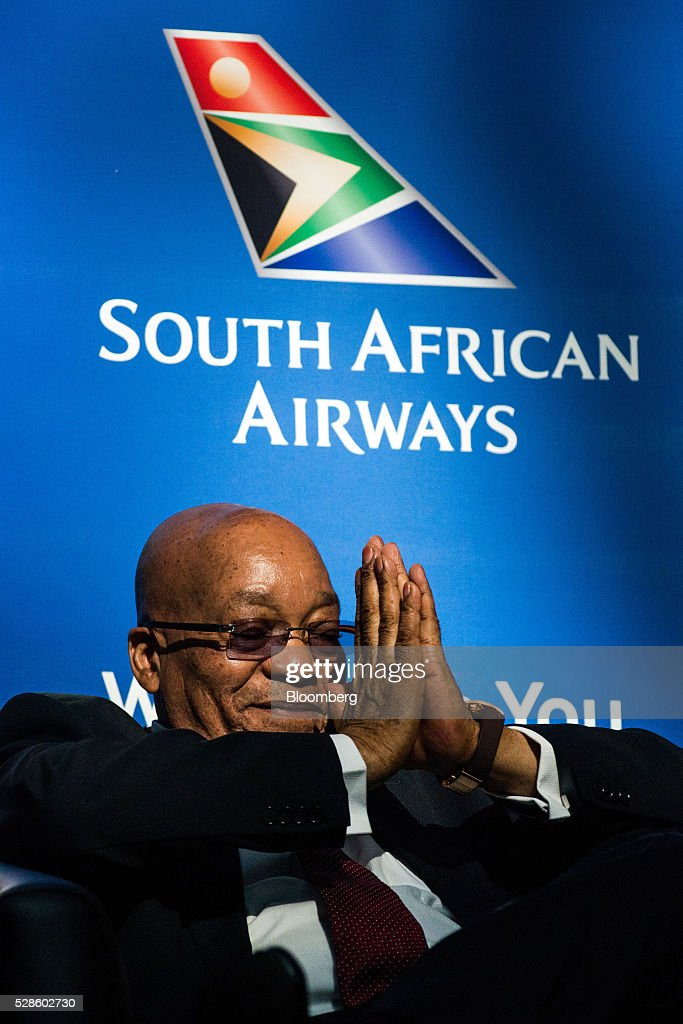 <a gi-track='captionPersonalityLinkClicked' href=/galleries/search?phrase=Jacob+Zuma&family=editorial&specificpeople=564982 ng-click='$event.stopPropagation()'>Jacob Zuma</a>, South Africa's president, gestures with his hands during a visit to the offices of South African Airways (SAA) in Johannesburg, South Africa, on Friday, May 6, 2016. It appears to be just a matter of time before South Africa's credit rating is cut to junk. Photographer: Waldo Swiegers/Bloomberg via Getty Images