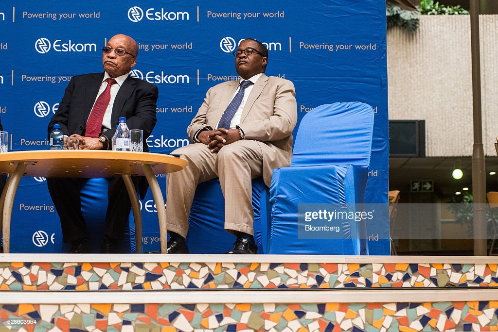 Jacob Zuma, South Africa's president, left, and Brian Molefe, chief executive officer of Eskom Holdings SOC Ltd., sit on the podium during speeches at the headquarters of Eskom Holdings SOC Ltd. at Megawatt Park in Johannesburg, South Africa, on Friday, May 6, 2016. It appears to be just a matter of time before South Africas credit rating is cut to junk. Photographer: Waldo Swiegers/Bloomberg via Getty Images