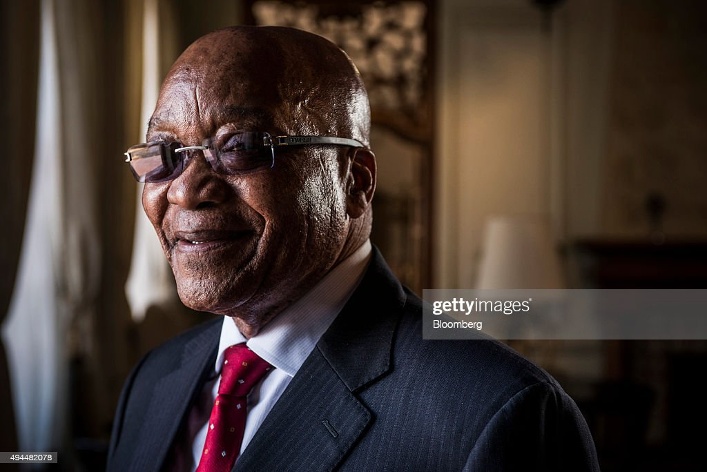 Jacob Zuma, South Africa's president, poses for a photograph following a Bloomberg Television interview at his state residence in Pretoria, South Africa, on Tuesday, Oct. 27, 2015. South Africa's economy is in trouble because of the global slowdown and the government faces a 'serious struggle' to meet its economic plan to cut unemployment and boost growth, Zuma said. Photographer: Waldo Swiegers/Bloomberg via Getty Images