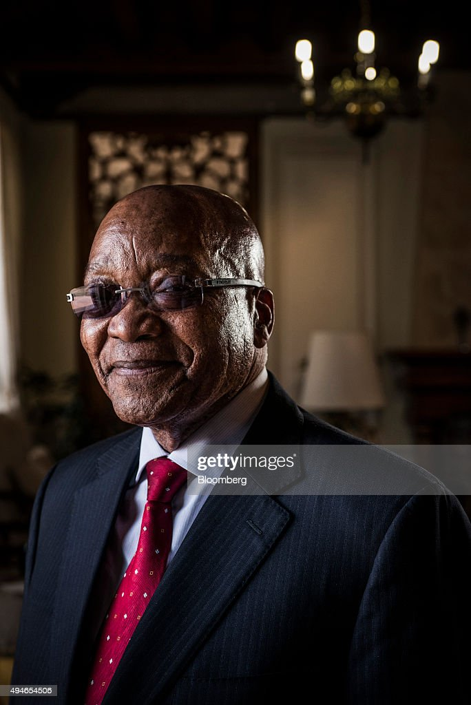 <a gi-track='captionPersonalityLinkClicked' href=/galleries/search?phrase=Jacob+Zuma&family=editorial&specificpeople=564982 ng-click='$event.stopPropagation()'>Jacob Zuma</a>, South Africa's president, poses for a photograph following a Bloomberg Television interview at his state residence in Pretoria, South Africa, on Tuesday, Oct. 27, 2015. South Africa's economy is in trouble because of the global slowdown and the government faces a 'serious struggle' to meet its economic plan to cut unemployment and boost growth, Zuma said. Photographer: Waldo Swiegers/Bloomberg via Getty Images
