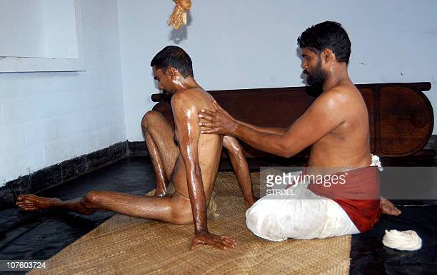 WITH 'HEALTHINDIATOURISM' BY JEEMON JACOBAn Indian Ayurvedic practitioner works with a client in Kovaram Thiruvananthapuram in India's southern state...