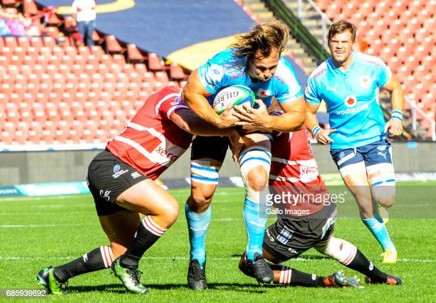 Jacobie Adriaanse of the Bulls tacked during the SuperSport Rugby Challenge match between Xerox Golden Lions and Vodacom Blue Bulls at Emirates...