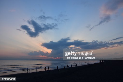 Jacob's ladder and people on the sunset beach : ストックフォト