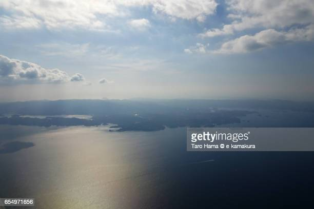 Jacob's ladder on Omura Bay, daytime aerial view from airplane