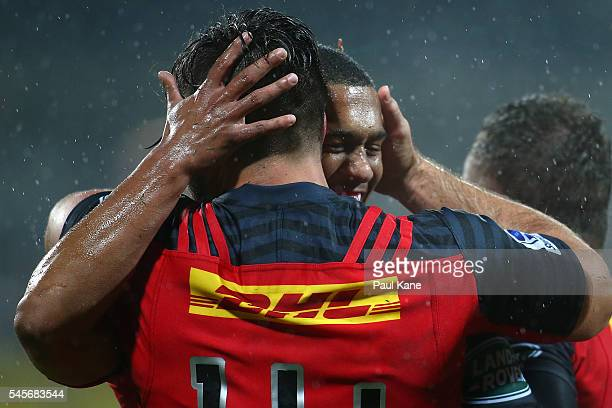 Jacobus Van Wyk and Leolin Zas of the Stormers celebrate after a try during the round 16 Super Rugby match between the Force and the Stormers at nib...