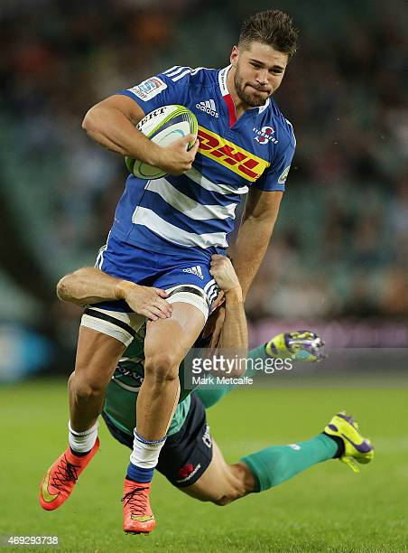 Jacobus Van Wyk of the Stormers is tackled by Rob Horne of the Waratahs during the round nine Super Rugby match between the Waratahs and the Stormers...