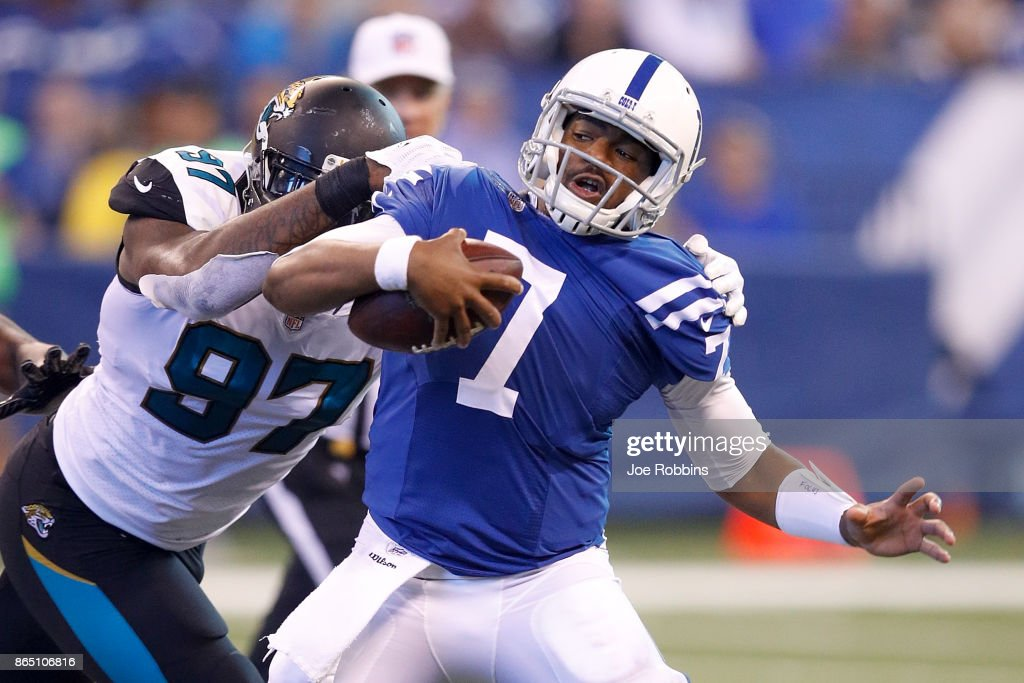 Jacoby Brissett #7 of the Indianapolis Colts is sacked by Malik Jackson #97 of the Jacksonville Jaguars during the first half at Lucas Oil Stadium on October 22, 2017 in Indianapolis, Indiana.