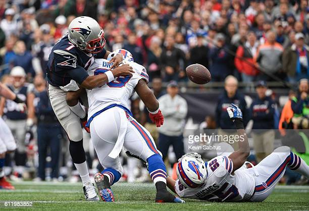 Jacoby Brissett of the New England Patriots fumbles in the second quarter while being tackled by Zach Brown of the Buffalo Bills at Gillette Stadium...