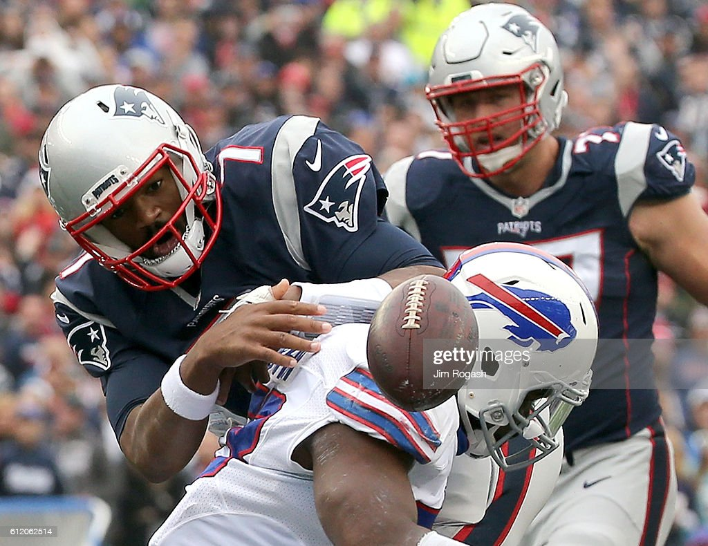 Jacoby Brissett #7 of the New England Patriots fumbles the ball as he is hit by Zach Brown #53 Buffalo Bills in the first half at Gillette Stadium on October 2, 2016 in Foxboro, Massachusetts.