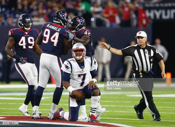 Jacoby Brissett of the New England Patriots is sacked by Shakeel Rashad of the Houston Texans as he celebrates with Tony Washington Jr #49 and Ufomba...