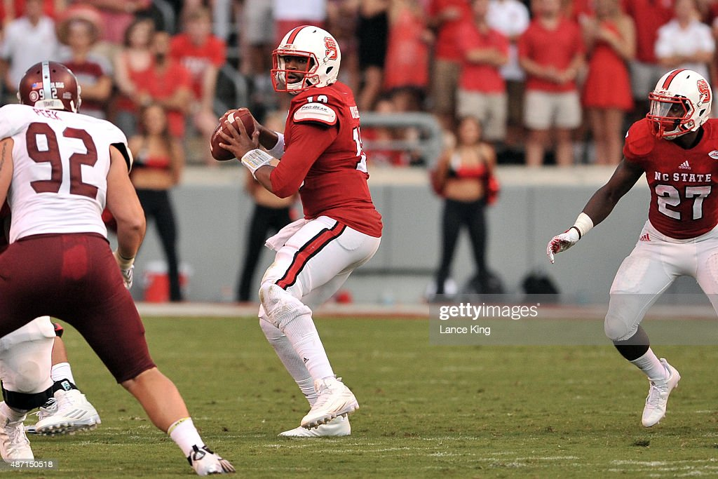 Jacoby Brissett #12 of the North Carolina State Wolfpack drops back to pass against the Troy Trojans at Carter-Finley Stadium on September 5, 2015 in Raleigh, North Carolina. NC State defeated Troy 49-21.