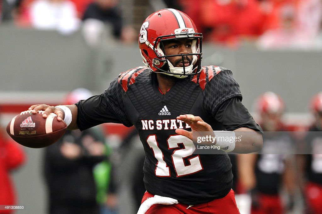 Jacoby Brissett #12 of the North Carolina State Wolfpack drops back to pass against the Louisville Cardinals at Carter-Finley Stadium on October 3, 2015 in Raleigh, North Carolina. Louisville defeated NC State 20-13.