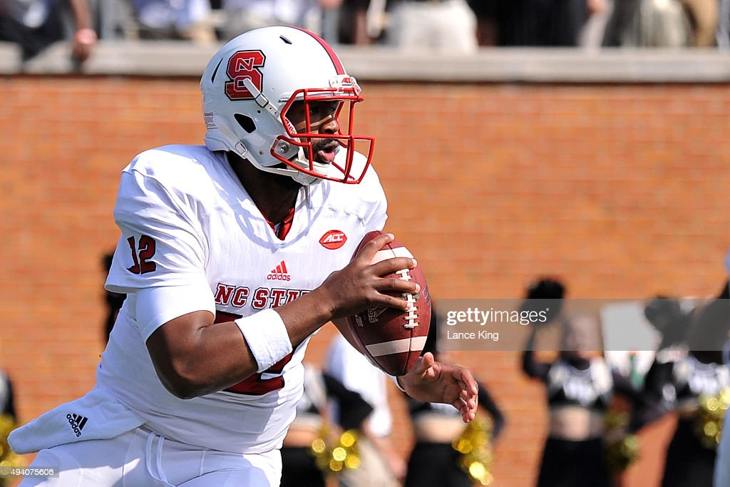 Jacoby Brissett #12 of the North Carolina State Wolfpack drops back to pass against the Wake Forest Demon Deacons at BB&T Field on October 24, 2015 in Winston-Salem, North Carolina.