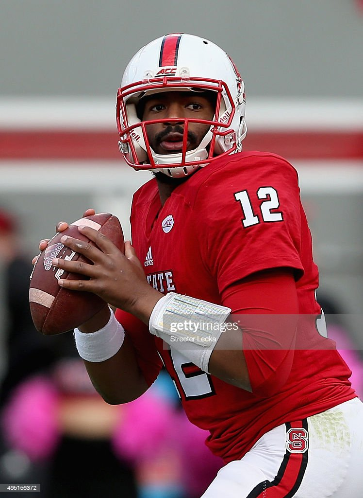 Jacoby Brissett #12 of the North Carolina State Wolfpack drops back to pass against the Clemson Tigers during their game at Carter-Finley Stadium on October 31, 2015 in Raleigh, North Carolina.