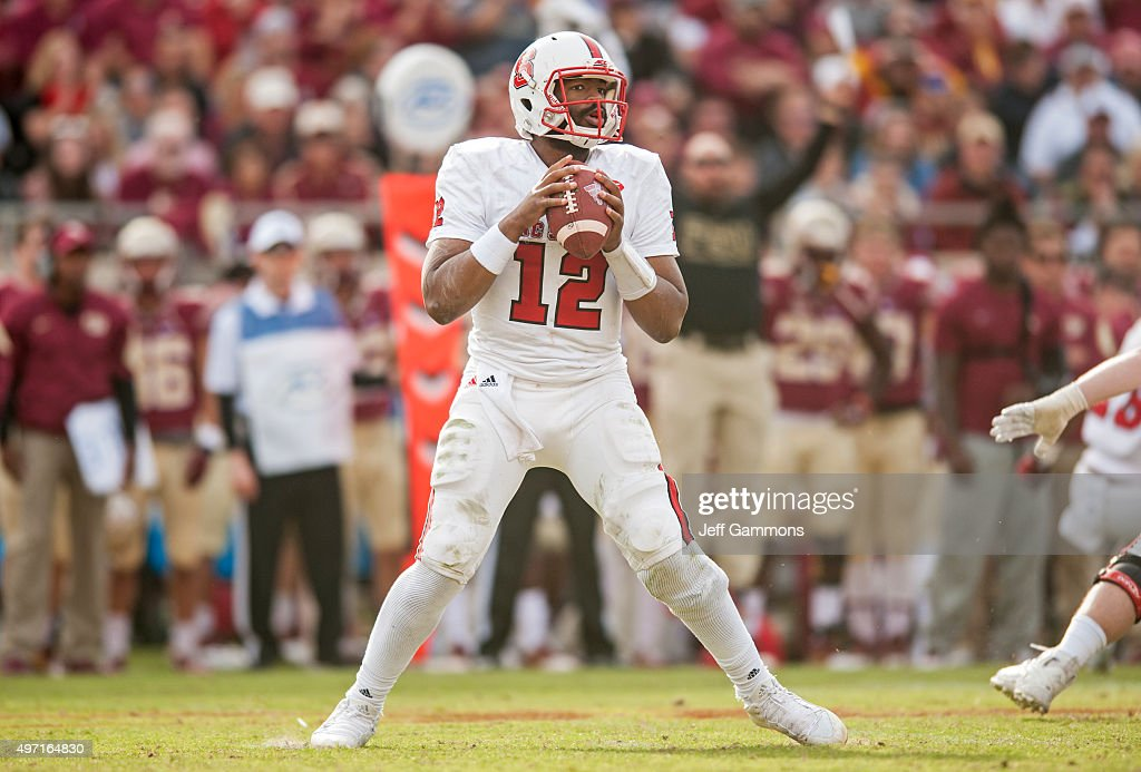 <a gi-track='captionPersonalityLinkClicked' href=/galleries/search?phrase=Jacoby+Brissett&family=editorial&specificpeople=8489613 ng-click='$event.stopPropagation()'>Jacoby Brissett</a> #12 of the North Carolina State Wolfpack looks for an open reciver during the game against the Florida State Seminoles at Doak Campbell Stadium on November 14, 2015 in Tallahassee, Florida. The Florida State Seminoles beat the North Carolina Wolfpack 34-17.