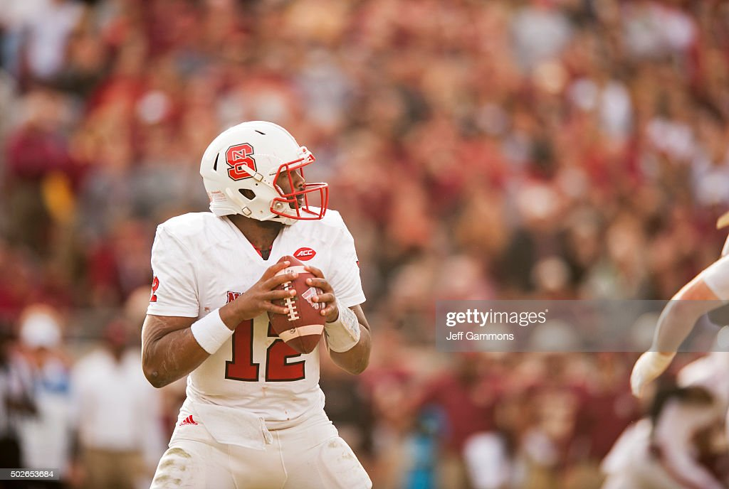 Jacoby Brissett #12 of the North Carolina State Wolfpack looks to make a pass against the Florida State Seminoles during the game at Doak Campbell Stadium on November 14, 2015 in Tallahassee, Florida. The Florida State Seminoles beat the North Carolina Wolfpack 34-17.