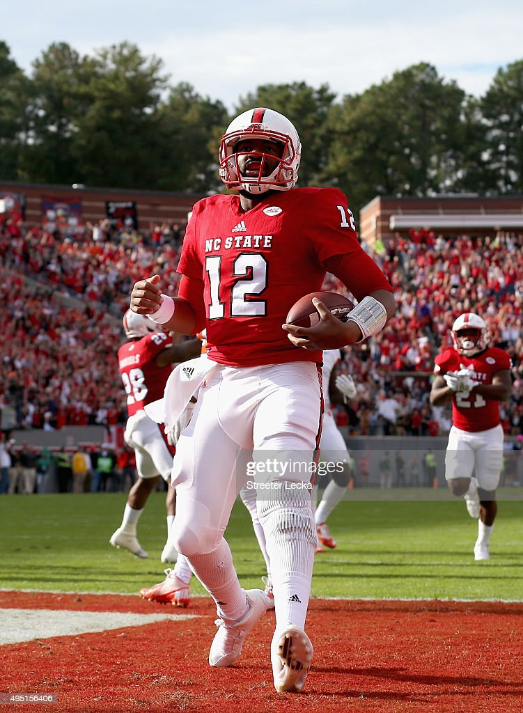 <a gi-track='captionPersonalityLinkClicked' href=/galleries/search?phrase=Jacoby+Brissett&family=editorial&specificpeople=8489613 ng-click='$event.stopPropagation()'>Jacoby Brissett</a> #12 of the North Carolina State Wolfpack runs for a touchdown in the first quarter against the Clemson Tigers during their game at Carter-Finley Stadium on October 31, 2015 in Raleigh, North Carolina.