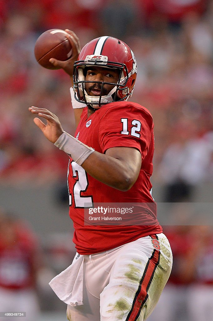 Jacoby Brissett #12 of the North Carolina State Wolfpack throws against the North Carolina Tar Heels during their game at Carter-Finley Stadium on November 28, 2015 in Raleigh, North Carolina. North Carolina won 45-34.