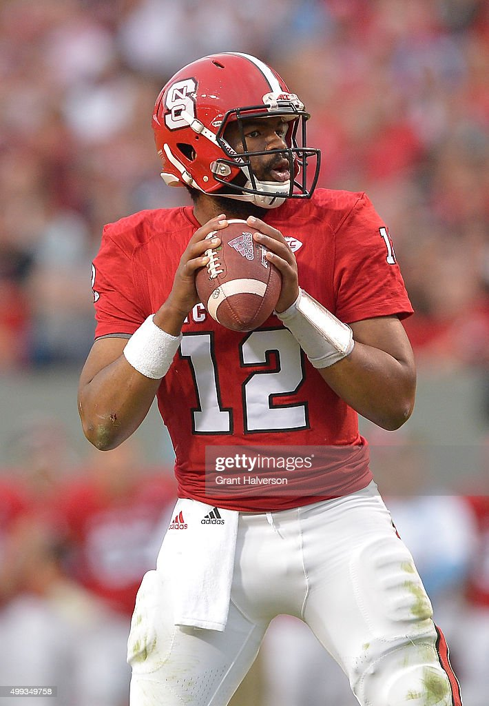 <a gi-track='captionPersonalityLinkClicked' href=/galleries/search?phrase=Jacoby+Brissett&family=editorial&specificpeople=8489613 ng-click='$event.stopPropagation()'>Jacoby Brissett</a> #12 of the North Carolina State Wolfpack throws against the North Carolina Tar Heels during their game at Carter-Finley Stadium on November 28, 2015 in Raleigh, North Carolina. North Carolina won 45-34.