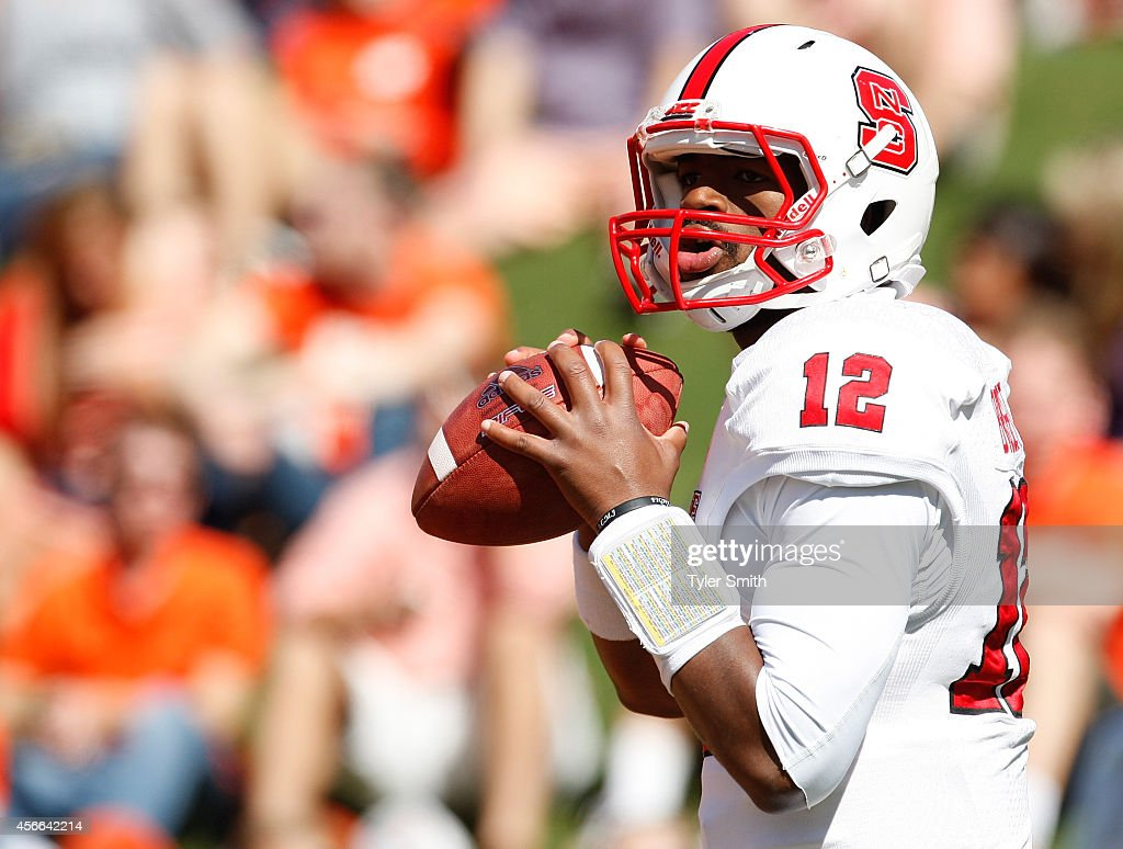 Jacoby Brissett #12 of the North Carolina State Wolfpack warms up prior to the game against the Clemson Tigers at Memorial Stadium on October 4, 2014 in Clemson, South Carolina.