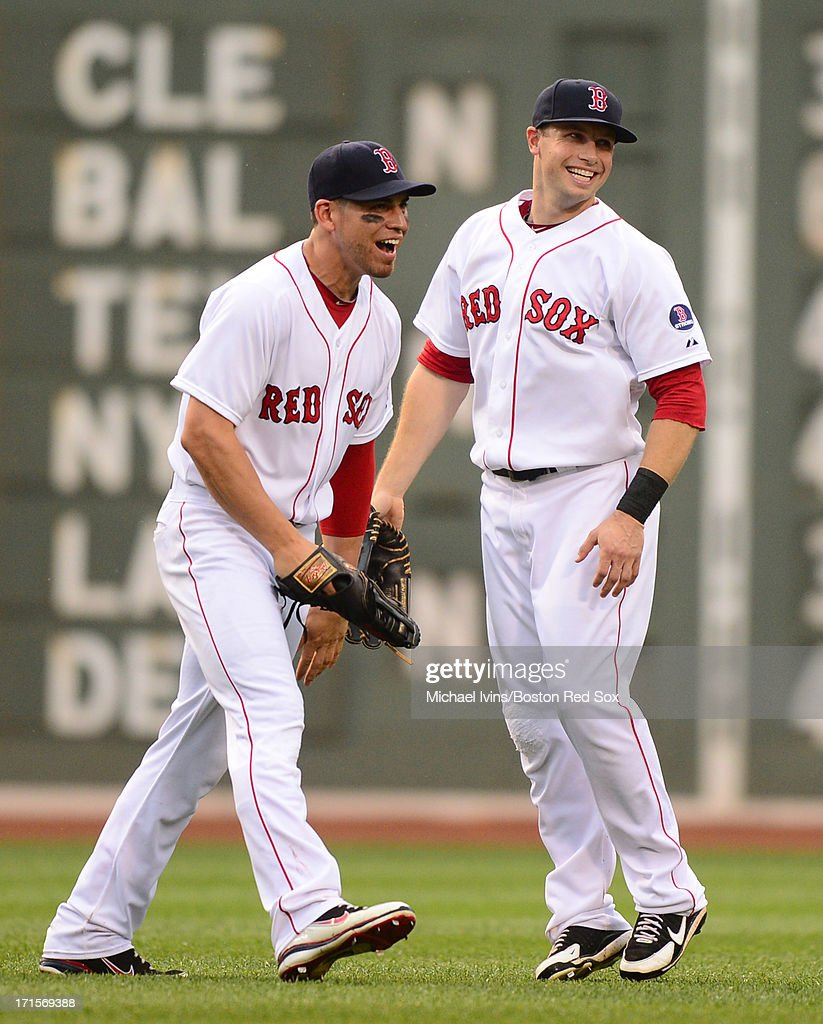 Jacoby Ellsbury #2 and Daniel Nava #29 of the Boston Red Sox celebrate a 5-3 win against the Colorado Rockies on June 26, 2013 at Fenway Park in Boston, Massachusetts.