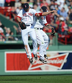 Jacoby Ellsbury and Daniel Nava of the Boston Red Sox celebrate a 61 win and a series sweep over the Houston Astros on April 28 2013 at Fenway Park...