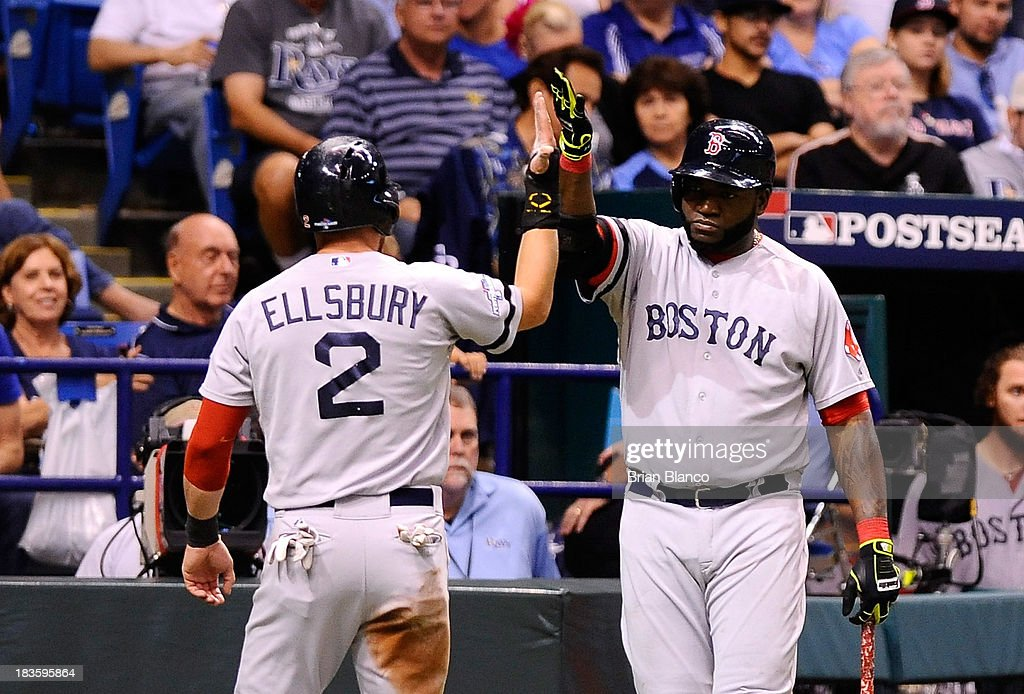 <a gi-track='captionPersonalityLinkClicked' href=/galleries/search?phrase=Jacoby+Ellsbury&family=editorial&specificpeople=4172583 ng-click='$event.stopPropagation()'>Jacoby Ellsbury</a> #2 and <a gi-track='captionPersonalityLinkClicked' href=/galleries/search?phrase=David+Ortiz&family=editorial&specificpeople=175825 ng-click='$event.stopPropagation()'>David Ortiz</a> #34 of the Boston Red Sox celebrate after Ellsbury scores off a wild pitch in the fifth inning against the Tampa Bay Rays during Game Three of the American League Division Series at Tropicana Field on October 7, 2013 in St Petersburg, Florida.