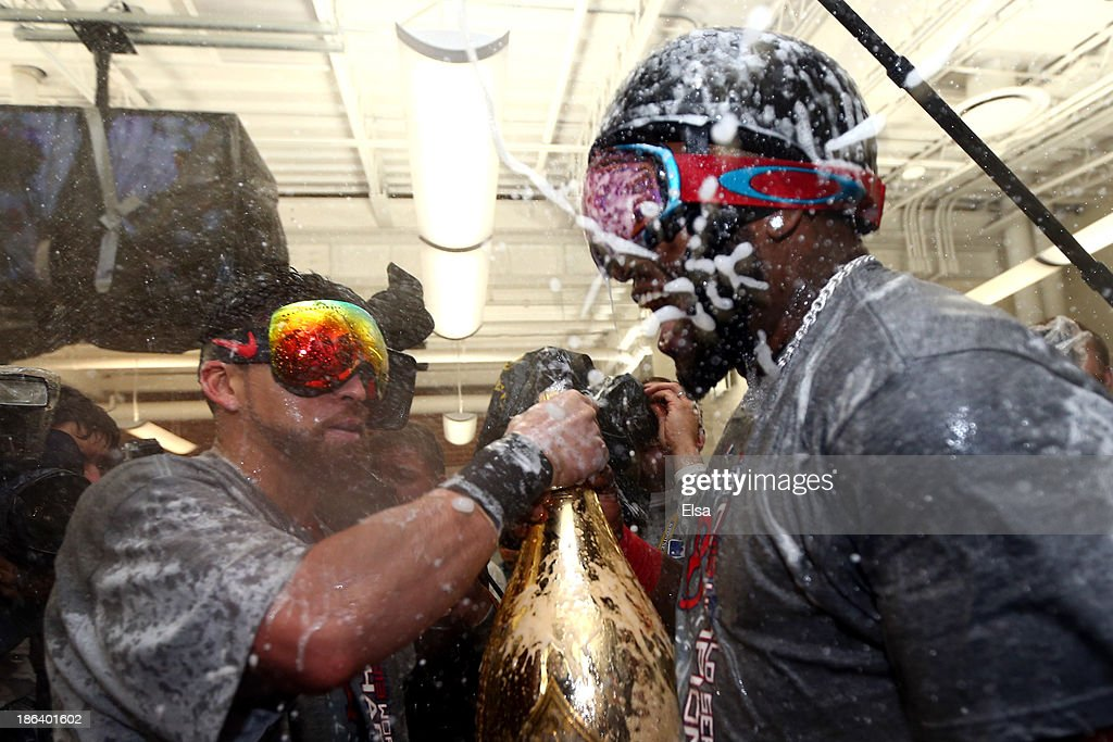 Jacoby Ellsbury #2 and David Ortiz #34 of the Boston Red Sox celebrate in the locker room after defeating the St. Louis Cardinals 6-1 in Game Six of the 2013 World Series at Fenway Park on October 30, 2013 in Boston, Massachusetts.