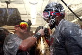 Jacoby Ellsbury and David Ortiz of the Boston Red Sox celebrate in the locker room after defeating the St Louis Cardinals 61 in Game Six of the 2013...