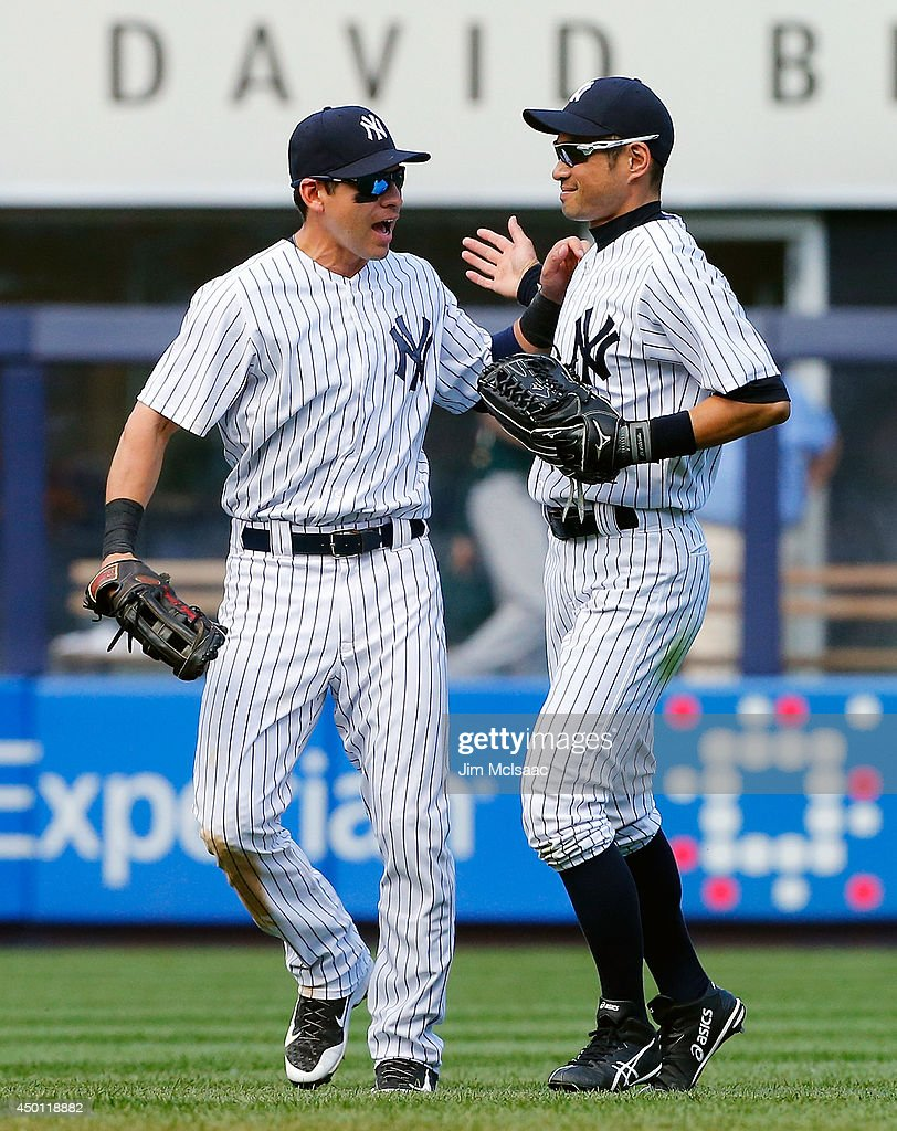 Jacoby Ellsbury and Ichiro Suzuki of the New York Yankees celebrate after defeating the Oakland Athletics at Yankee Stadium on June 5 2014 in the...