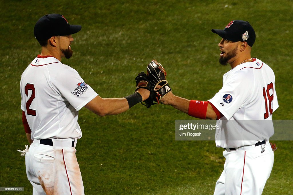 Jacoby Ellsbury #2 and Shane Victorino #18 of the Boston Red Sox celebrate in the eighth inning after Victorino makes a catch against the St. Louis Cardinals during Game Six of the 2013 World Series at Fenway Park on October 30, 2013 in Boston, Massachusetts.