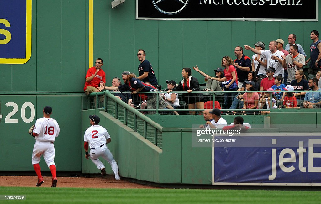 <a gi-track='captionPersonalityLinkClicked' href=/galleries/search?phrase=Jacoby+Ellsbury&family=editorial&specificpeople=4172583 ng-click='$event.stopPropagation()'>Jacoby Ellsbury</a> #2 of the Boson Red Sox and teammate <a gi-track='captionPersonalityLinkClicked' href=/galleries/search?phrase=Shane+Victorino&family=editorial&specificpeople=576251 ng-click='$event.stopPropagation()'>Shane Victorino</a> #18 chase down a long fly ball that scored two runs in the seventh inning against the Detroit Tigers at Fenway Park on September 2, 2013 in Boston, Massachusetts.