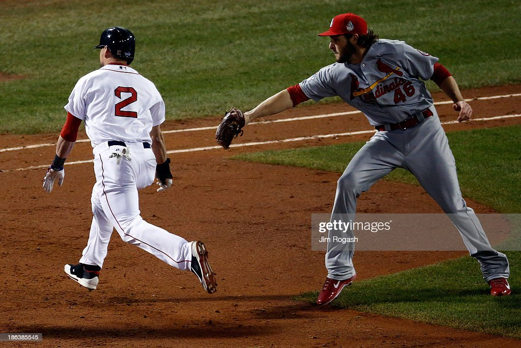 Jacoby Ellsbury of the Boston Red Sox avoids a tag by Kevin Siegrist of the St Louis Cardinals in the fifth inning during Game Six of the 2013 World...