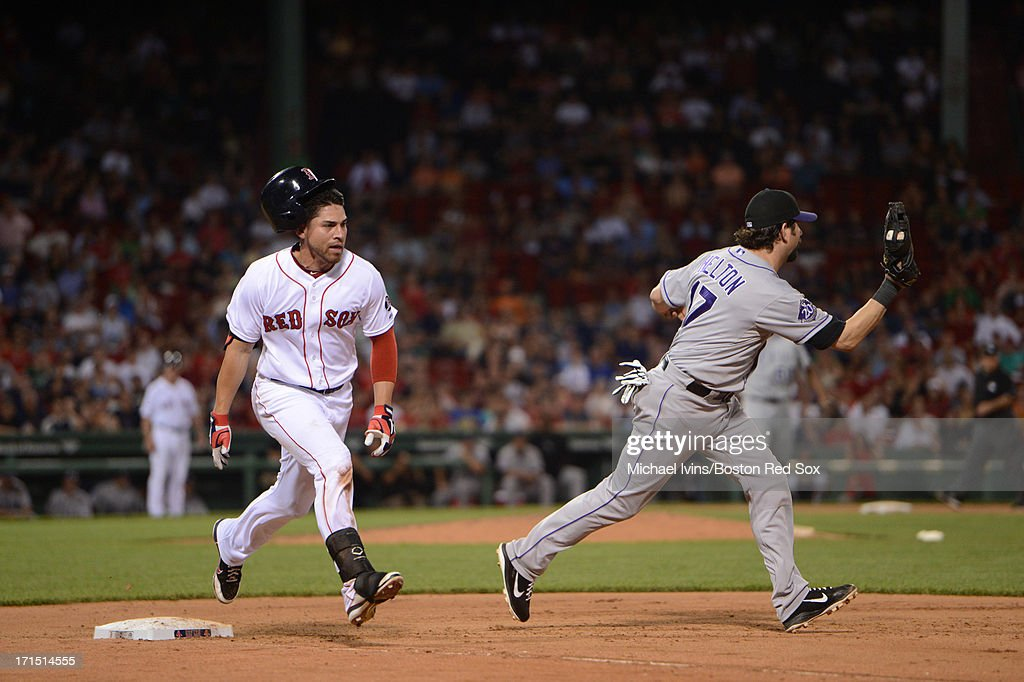 <a gi-track='captionPersonalityLinkClicked' href=/galleries/search?phrase=Jacoby+Ellsbury&family=editorial&specificpeople=4172583 ng-click='$event.stopPropagation()'>Jacoby Ellsbury</a> #2 of the Boston Red Sox beats out a throw to <a gi-track='captionPersonalityLinkClicked' href=/galleries/search?phrase=Todd+Helton&family=editorial&specificpeople=200735 ng-click='$event.stopPropagation()'>Todd Helton</a> #17 of the Colorado Rockies in the seventh inning on June 25, 2013 at Fenway Park in Boston, Massachusetts.