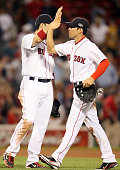 Jacoby Ellsbury of the Boston Red Sox celebrates the win with teammate Adrian Gonzalez on July 7 2011 at Fenway Park in Boston Massachusetts The...