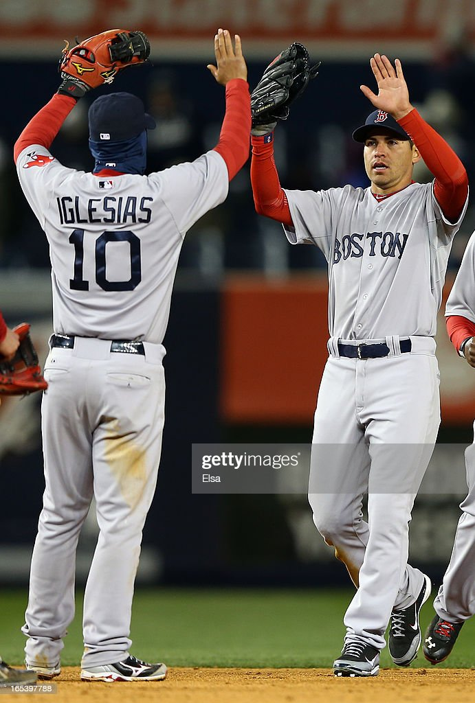 Jacoby Ellsbury #2 of the Boston Red Sox celebrates the win with teamamte Jose Iglesias #10 after the game against the New York Yankees on April 3, 2013 at Yankee Stadium in the Bronx borough of New York City.The Boston Red Sox defeated the New York Yankees 7-4.