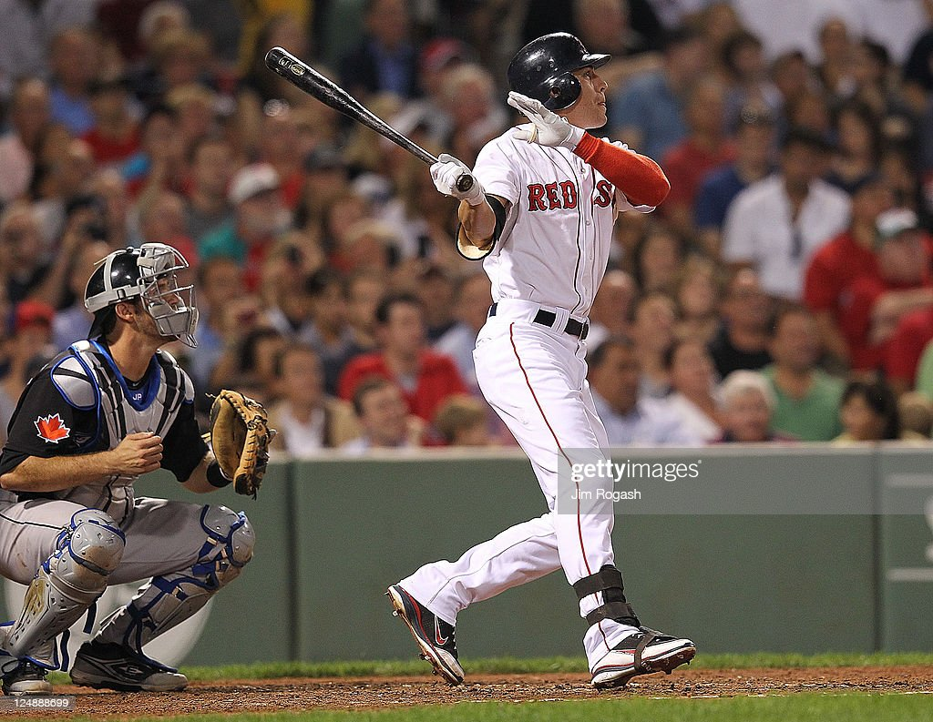Jacoby Ellsbury #2 of the Boston Red Sox connects for a home run in the fourth inning against the Toronto Blue Jays at Fenway Park September 13, 2011 in Boston, Massachusetts.