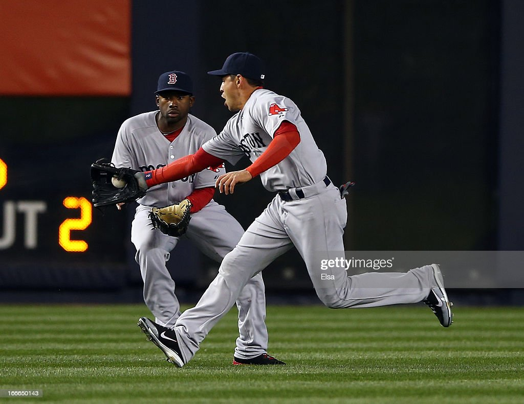 <a gi-track='captionPersonalityLinkClicked' href=/galleries/search?phrase=Jacoby+Ellsbury&family=editorial&specificpeople=4172583 ng-click='$event.stopPropagation()'>Jacoby Ellsbury</a> #2 of the Boston Red Sox fields a hit as teammate Jackie Bradley Jr. #44 looks on against the New York Yankees on April 4, 2013 at Yankee Stadium in the Bronx borough of New York City.
