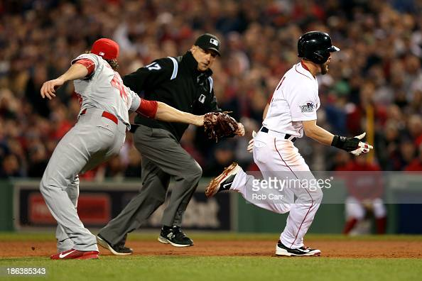 Jacoby Ellsbury of the Boston Red Sox gets out of a rundown in the fifth inning against the St Louis Cardinals during Game Six of the 2013 World...