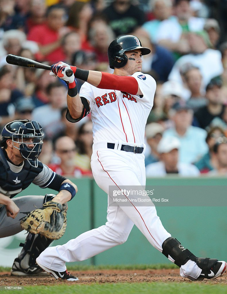 Jacoby Ellsbury #2 of the Boston Red Sox hits an RBI double against the New York Yankees during the sixth inning on August 17, 2013 at Fenway Park in Boston Massachusetts.