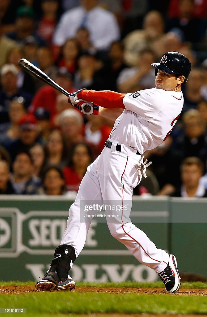 Jacoby Ellsbury #2 of the Boston Red Sox hits the game-winning RBI hit in the bottom of the ninth inning against the New York Yankees during the game on September 11, 2012 at Fenway Park in Boston, Massachusetts.