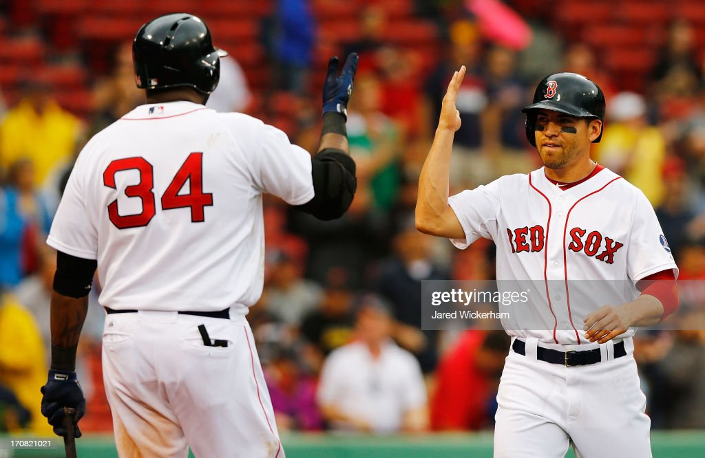 <a gi-track='captionPersonalityLinkClicked' href=/galleries/search?phrase=Jacoby+Ellsbury&family=editorial&specificpeople=4172583 ng-click='$event.stopPropagation()'>Jacoby Ellsbury</a> #2 of the Boston Red Sox is congratulated by teammate <a gi-track='captionPersonalityLinkClicked' href=/galleries/search?phrase=David+Ortiz&family=editorial&specificpeople=175825 ng-click='$event.stopPropagation()'>David Ortiz</a> #34 of the Boston Red Sox after scoring on an RBI triple in the sixth inning against the Tampa Bay Rays during the game on June 18, 2013 at Fenway Park in Boston, Massachusetts.